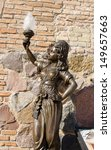 Small photo of retro historic nympho sculpture near museum entrance holding lighting lamp in hand.