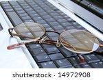 glasses lying on laptops