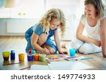 portrait of cute girl painting... | Shutterstock . vector #149774933