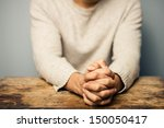 praying man at desk | Shutterstock . vector #150050417