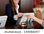 smiling female receptionist... | Shutterstock . vector #150086057