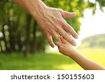 a hand of parent and child in... | Shutterstock . vector #150155603
