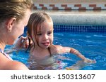 mother and daughter playful in... | Shutterstock . vector #150313607