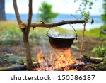 cooking in a pot on the fire | Shutterstock . vector #150586187