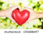 heart in hands on nature... | Shutterstock . vector #150688697