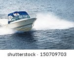 Man Piloting Motorboat On Lake...