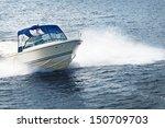 Man Piloting Motorboat On Lake...
