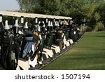 Golf Carts Are Lined Up At The...