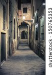 Small photo of Dark alley in Florence, Tuscany