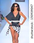 miami  fl   july 21  a model...   Shutterstock . vector #150939047