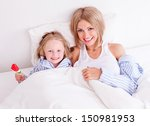 happy young mother with her... | Shutterstock . vector #150981953