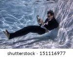 Man Underwater Reading