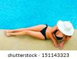 Young Woman Relaxing By The Pool