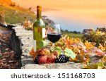 red wine and grapes. terrace... | Shutterstock . vector #151168703
