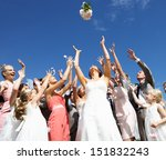 Bride Throwing Bouquet For...