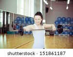 young woman lifting weights in... | Shutterstock . vector #151861187
