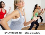Group Of Women Exercising In...