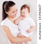 beautiful young mother holding... | Shutterstock . vector #151963637