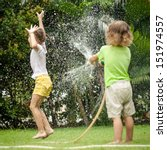 little boy is pouring a water... | Shutterstock . vector #151974557