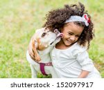 Stock photo happy girl with a dog licking her face 152097917