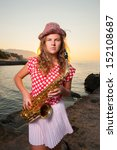 Girl Playing On Saxophone...