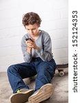 A Teenage Boy  Sitting On His...