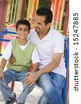 father and son in playground on ... | Shutterstock . vector #15247885