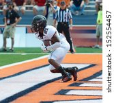 Small photo of CHAMPAIGN,IL-AUGUST 31: SIU wide receiver LaSteven McKinney (21) receives a kickoff in the end zone for a touchback during the first quarter of a game on Saturday, Aug 31, 2013.