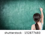 girl drawing e mc2 on chalkboard | Shutterstock . vector #152877683