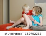 two children playing on a...   Shutterstock . vector #152902283