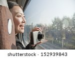 young woman taking photographs... | Shutterstock . vector #152939843