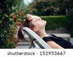 woman sunbathing in the yard   Shutterstock . vector #152953667
