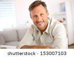 attractive smiling man relaxing ... | Shutterstock . vector #153007103