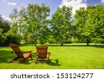 two wooden adirondack chairs on ... | Shutterstock . vector #153124277