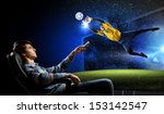 young man watching football... | Shutterstock . vector #153142547