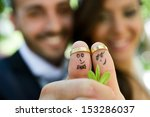 wedding rings on their fingers... | Shutterstock . vector #153286037
