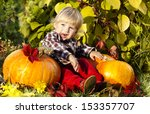 Little Happy Boy And Pumpkins...