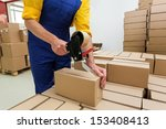 factory worker with packing... | Shutterstock . vector #153408413