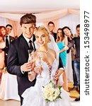 happy wedding couple drinking... | Shutterstock . vector #153498977