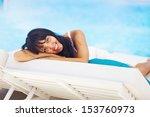 woman relaxing in resort on a... | Shutterstock . vector #153760973