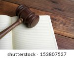 wooden gavel and open book on