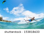 young man kiteboarding  fun in... | Shutterstock . vector #153818633
