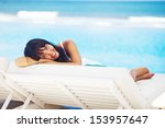 woman relaxing in resort on a... | Shutterstock . vector #153957647