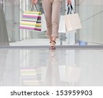 woman in the shopping mall | Shutterstock . vector #153959903