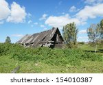 Small photo of Old abounded house in a Russian village