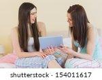 happy friends in pajamas...   Shutterstock . vector #154011617