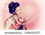portrait of a japanese geisha... | Shutterstock . vector #154014527
