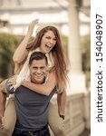 young couple laughing in the...   Shutterstock . vector #154048907