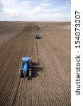 Постер, плакат: Image of three Tractors
