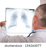 portrait of a doctor looking at ... | Shutterstock . vector #154263077